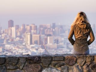 Woman overlooking the San Francisco Skyline